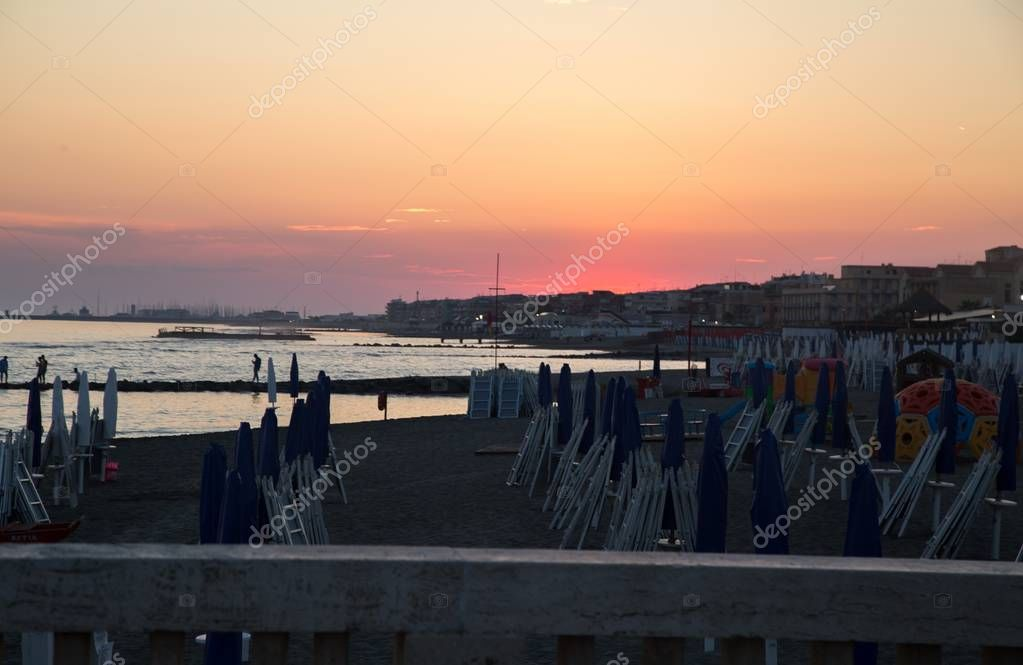 view of beach at Ostia on sunset background, Rome