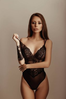 Sensual young model posing in lace bodysuit