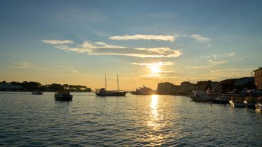 Sunset with ships in the port city of Porec in Istria in Croatia