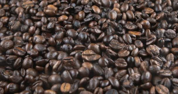 Coffee beans are roasted in a frying pan