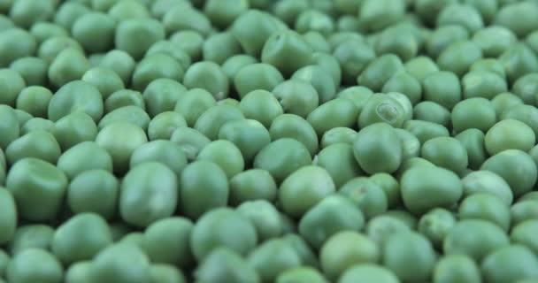frische grüne Erbsen rotieren. Lebensmittel-Hintergrund