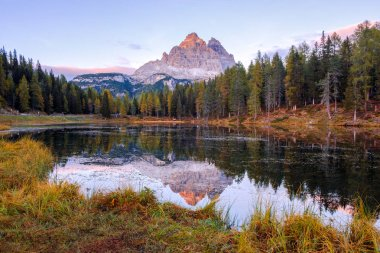 Beautiful Lago Di Antorno lake at background Drei Zinnen (Tre Cime di Lavaredo) mountain on the Dolomites in Italy