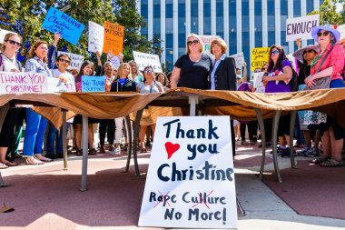 September 27, 2018 Palo Alto / CA / USA - Rally in support of Christine Blasey Ford in front of the Palo Alto City Hall; Liz Kniss, the mayor, poses surrounded by participants;