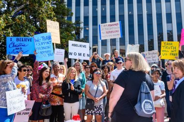 September 27, 2018 Palo Alto / CA / USA - Rally in support of Christine Blasey Ford in front of the Palo Alto City Hall; The Mayor, Liz Kniss, surrounded by participants holding signs