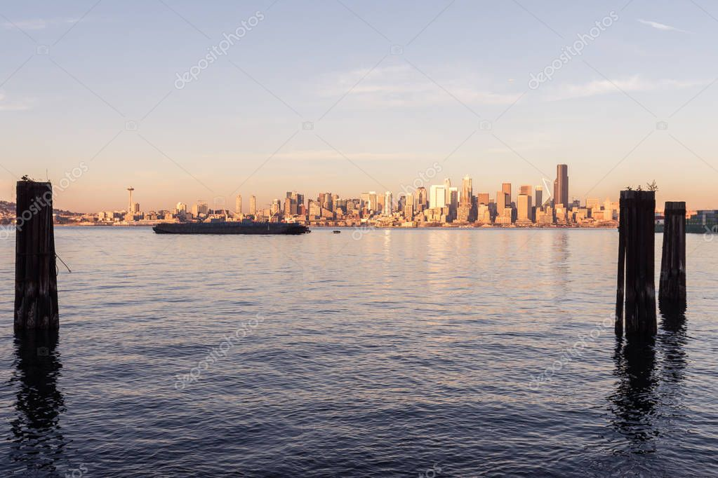 Elliott Bay, Seattle Bay, sunset light on skyscrapers of downtown in the background, Washington, USA