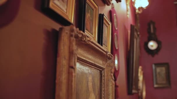 vintage paintings on the wall in retro frame