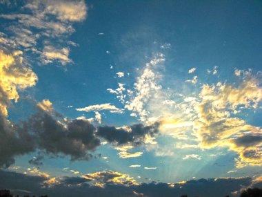 Magic sunset. Beautiful dark clouds at sunset after a thundersto