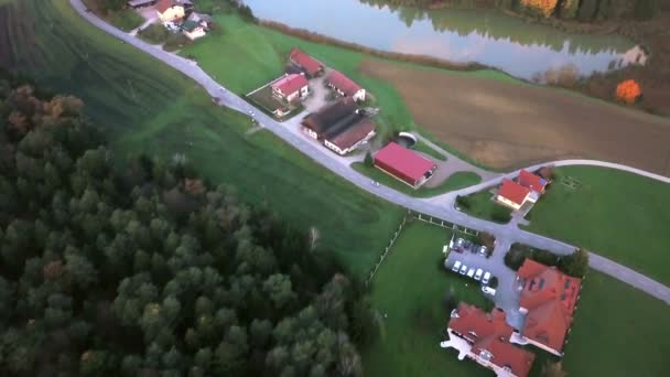 Aerial: Filming beautiful Slovenian country landscape at autumn early morning. Flying on cold autumn morning with beautiful sunrise.