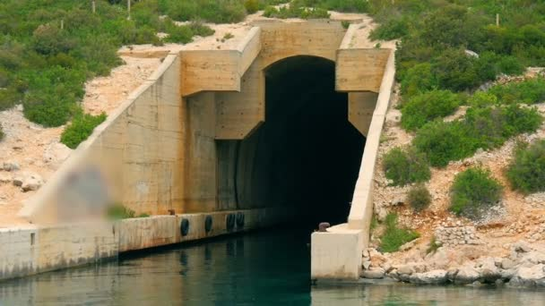 Old abandoned concrete hiding bunker for military ships on Croatian island. Filmed on sailing trip in Croatia in slow motion hd.