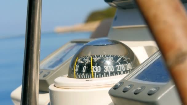 Closeup on navigating instruments behind steering wheel of sailing boat. Filmed on sailing trip in Croatia in slow motion hd.