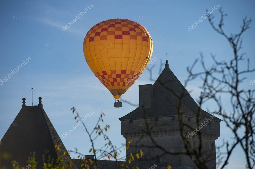 Hot air balloon in the sky of Castelnaud in Dordogne, France