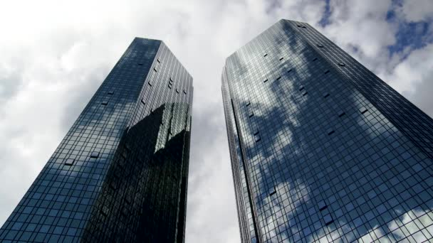 Glass Skyscraper Towers and Cloudscape Reflections