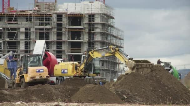 Stavební práce na staveništi a Vykopávačů