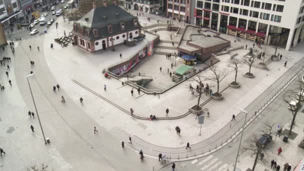 Street camera view of people activity in pedestrian zone of Frankfurt. Wide shot.