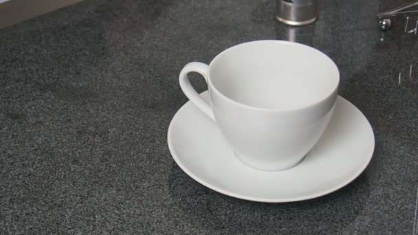 hot tea pouring in white cup on table