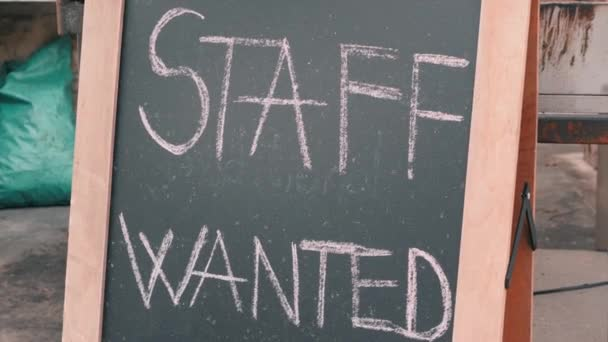 Staff wanted chalk board sign. Vacancy sign on black chalkboard. Headhunter concept. Job hire concept.