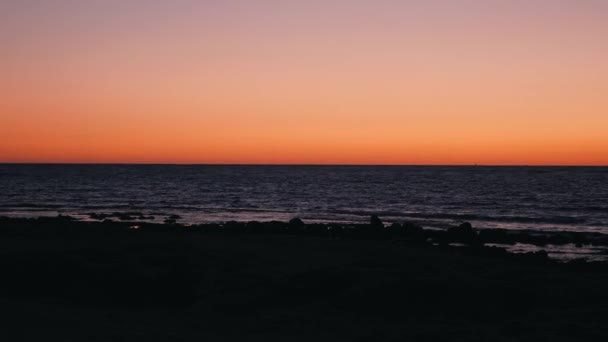Calm mediterranean sea at beautiful sundown. Sun setting down over ocean. Orange sky at sea sunset. Sea with orange horizon at sunset