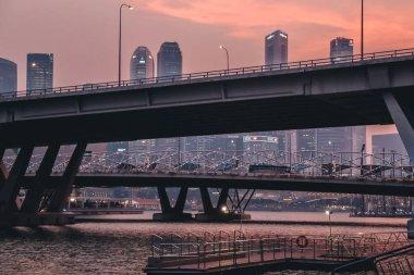 Bridge over river in Singapore during sunset