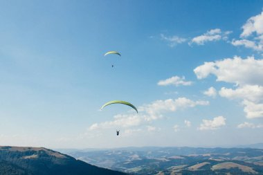 Mountain panorama with paragliders