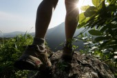 successful hiker hiking on summer sunrise mountain top