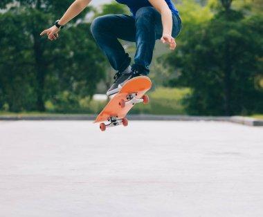 Cropped image of skateboarder sakteboarding on parking lot stock vector