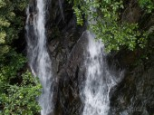 Fotografie Aerial View of Waterfall in the Tropical Rainforest Mountains