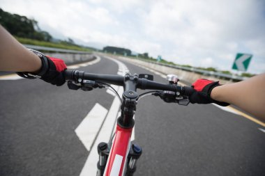 Cyclist Riding Mountain Bike on highway