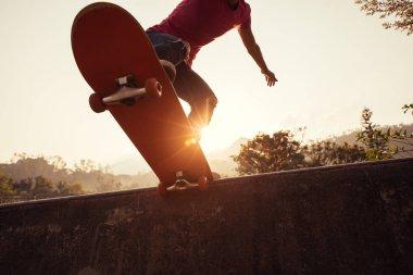 Cropped shot of skateboarder skateboarding at skatepark stock vector