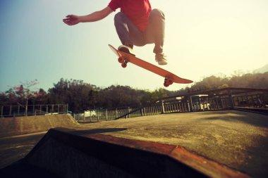 Cropped shot of skateboarder skateboarding at skatepark ramp stock vector