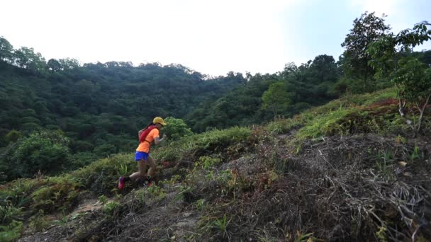 Two female ultramarathon runners jogging in park at daytime