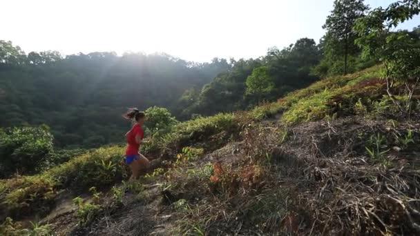 Slow-motion footage of fit female ultramarathon runner jogging in park at daytime