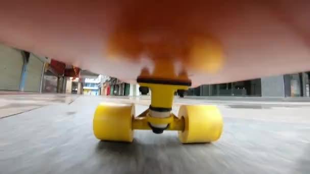 bottom footage of skateboarder skateboarding in the city