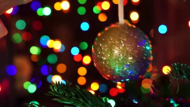 Hand woman decorating on Christmas tree with Christmas glow lights.
