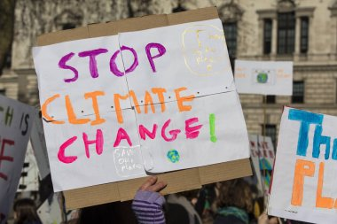 Protestors holding climate change banners at a protest