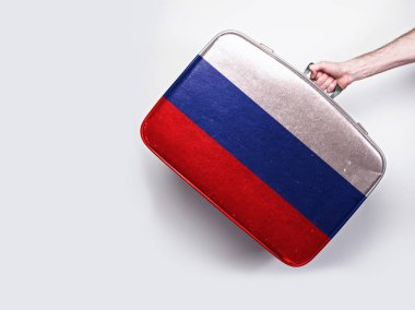 Russia flag on a vintage leather suitcase.