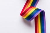 Gay pride LGBT rainbow ribbon on white background