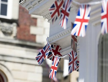 Union Jack flags hang in Windsor in preperation for the royal we