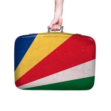 Seychelles flag on a vintage leather suitcase.
