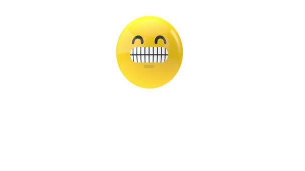 Skákající žlutý emoji šklebící se tvář na bílém pozadí