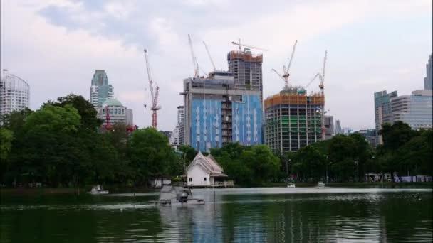 Time-lapse building under construction near lumpini public park in Bangkok, Thailand