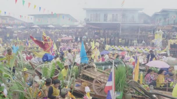 AUTTHAYA, THAILAND - JULY 25 : Traditional parade procession lent candle festival for Asalha Puja and Buddhist Lent Day in waterway by boat at Wat Lat Chado on July 25, 2018 in Aytthaya, Thailand