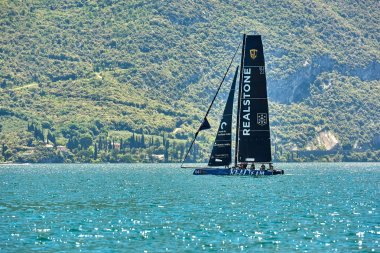 Riva del Garda,Lago di Garda ,Italy - 25 May 2018:Catamaran competes during  for the first GC32 World Championship out of Riva del Garda, Italy.The speed races of the sailing GC 3