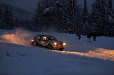 Covasna, ROMANIA,12 January 2019:Old car participating in HISTORIC WINTER RALLY