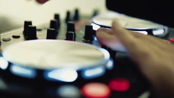 DJ works behind the DJ keyboard