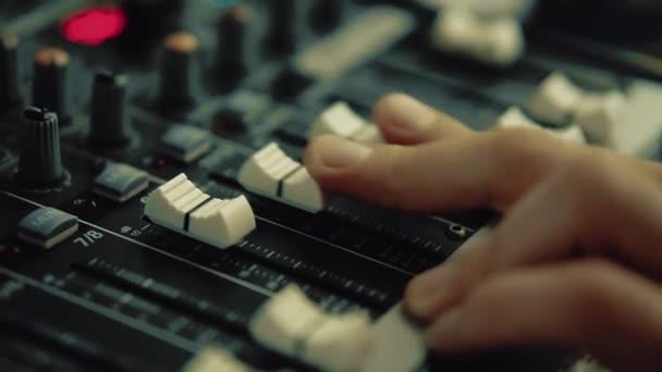 DJ works on the DJ console