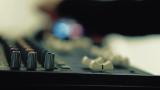 DJ works behind the keyboard