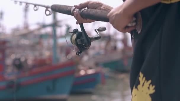 person in traditional dressing catches fish closeup