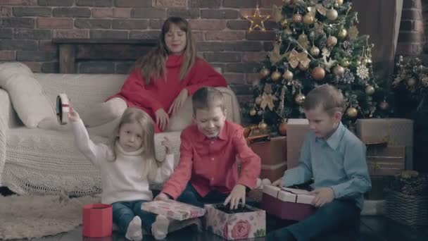 Happy children open christmas gift boxes lady watches