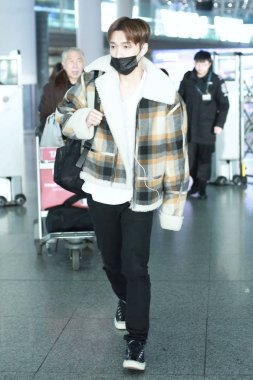 Chinese singer and actor Zhang Yixing, better known as Lay, of South Korean-Chinese boy group EXO, arrives at the Beijing Capital International Airport in Beijing, China, 17 December 2018.