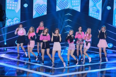 Members of South Korean girl group Fromis 9 perform during the South Korean music TV series